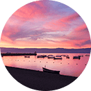 Bright pink sunset over the Chapala lake and boats