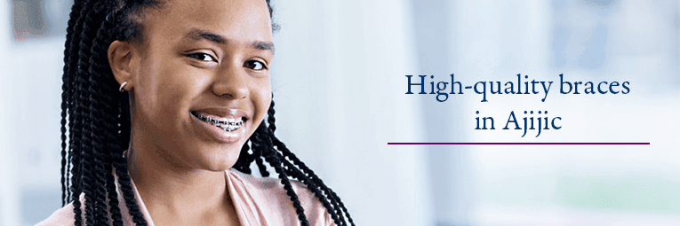 Young African American girl smiling with traditional braces