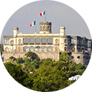 Chapultepec castle with two Mexican flags waving