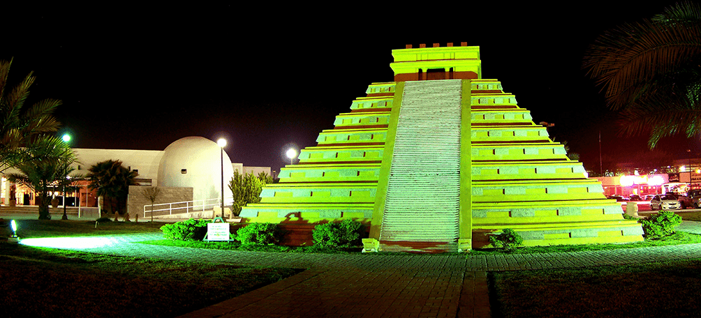 Pyramid of the plaza de las culturas at night with green light